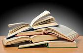 Högen av böcker isolerad på grå bakgrund — Stockfoto