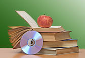 Apple, dvd, and books as a symbol of transition from old to new — Foto de Stock