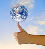 Planet earth on finger.Elements of this image furnished by NASA — Stock Photo