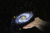 Galaxy in palms.Elements of this image furnished by NASA — Stock Photo