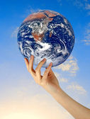 Planet earth in finger.Elements of this image furnished by NASA — Stock Photo