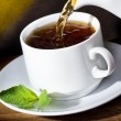 Stock Photo: Pouring tea into cup of tea