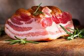 Smoked bacon with rosemary — Stock Photo