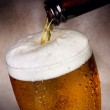 Beer pouring into glass — Stock Photo