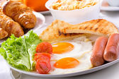 Breakfast with fried eggs — Stock Photo