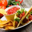 Plate with taco, nachos chips, tomato dip — Stock Photo #8668546