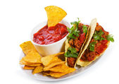 Plate with taco, tortilla chips and tomato dip — Foto de Stock