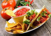 Plate with taco, nachos chips, tomato dip — Foto de Stock