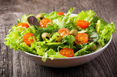 Salad with vegetables and greens — Stock Photo