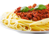 Pasta with meat sauce on a white background — Stock Photo