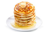 Pancakes with butter and syrup — Stock Photo