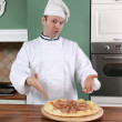 Chef and pizza — Stock Photo