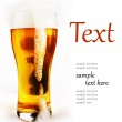 Cold glass of beer with foam — Stock Photo #8838825