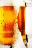 Cold glass of beer with foam — Stock Photo