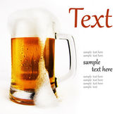 Cold glass of beer with foam — Stok fotoğraf