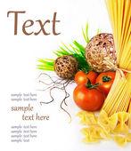 Ingredients of pasta, tomatoes, herbs — Stock Photo