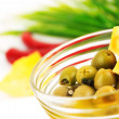 Olives with slices of cheese in a glass - Stock Photo