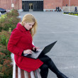 Girl with laptop on university back - Stock Photo