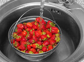 Strawberry under current water — Stock Photo