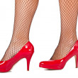 Woman's legs with red high hill shoes — Stockfoto
