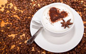 Frothed coffee with heart shape and star aneceed — Stock Photo