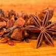 Stock Photo: Star aniseed lying on wooden board