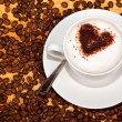 Stock Photo: Cacao heart in white frothed coffee