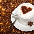 Stock Photo: Star aniseed and cacao heart in coffee