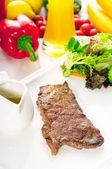 Juicy BBQ grilled rib eye ,ribeye steak and vegetables — Stock Photo