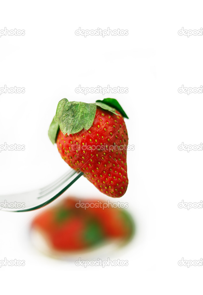 Fresh strawberry on a fork over white — Stock Photo #8416367