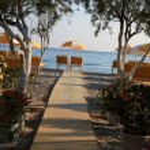 Two chairs and umbrella on the beach . Tigaki,Greece — Stock Photo