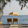Two chairs and umbrella on the  beach . Tigaki,Greece — Photo