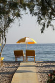 Two chairs and umbrella on the beach . Tigaki,Greece — Stock Photo