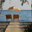 Two chairs and umbrella on the  beach . Tigaki,Greece — Foto de Stock