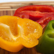 Close up of red, yellow and green peppers — Photo