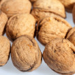 Close up of many scattered walnuts. - Stock Photo