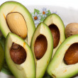 Fresh Avocado Halves On Plate - Stock Photo
