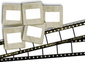 Vintage blank film stripes and blank old slide photo frames on w — Stock Photo