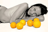 Naked girl and oranges — Stock Photo