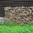 Firewood against wooden wall — Stock Photo #8328277