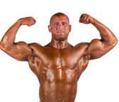 Bodybuilder flexing — Stock Photo