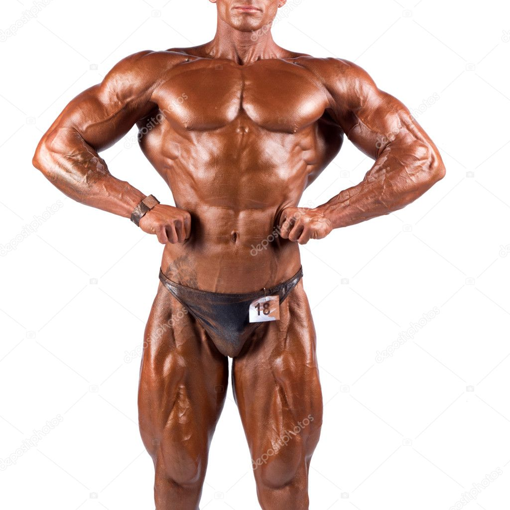 Bodybuilder flexing his muscles in studio — Stock Photo #9624219
