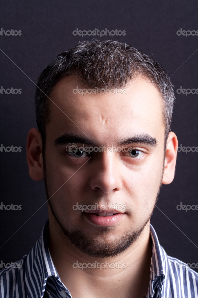 Handsome young man portrait over black — Stock Photo #9887853