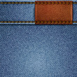 Jeans texture with leather label — Vector de stock