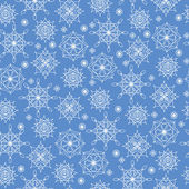 Winter seamless background with snowflakes — Stock Vector