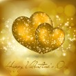 Valentine's day greeting card with two golden hearts — Stock Vector