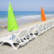 Stock Photo: Beach chair and colorful umbrellon beach