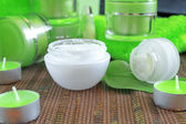 Creams for body care in transparent and green containers — Stock Photo