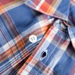 Bright multi-colored plaid shirt with collar — Stock Photo #10394772