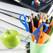 Stock Photo: Office supply and apple